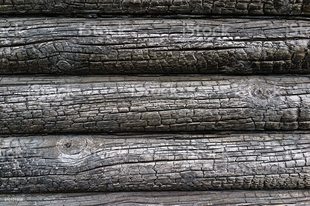 Burnt wooden house wall stock photo