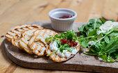 Burrata on toast with arugula and jam