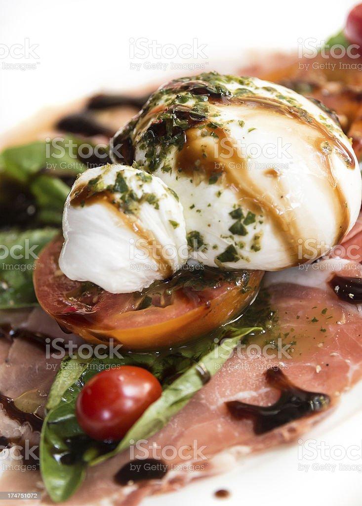 Burrata with italian prosciutto stock photo