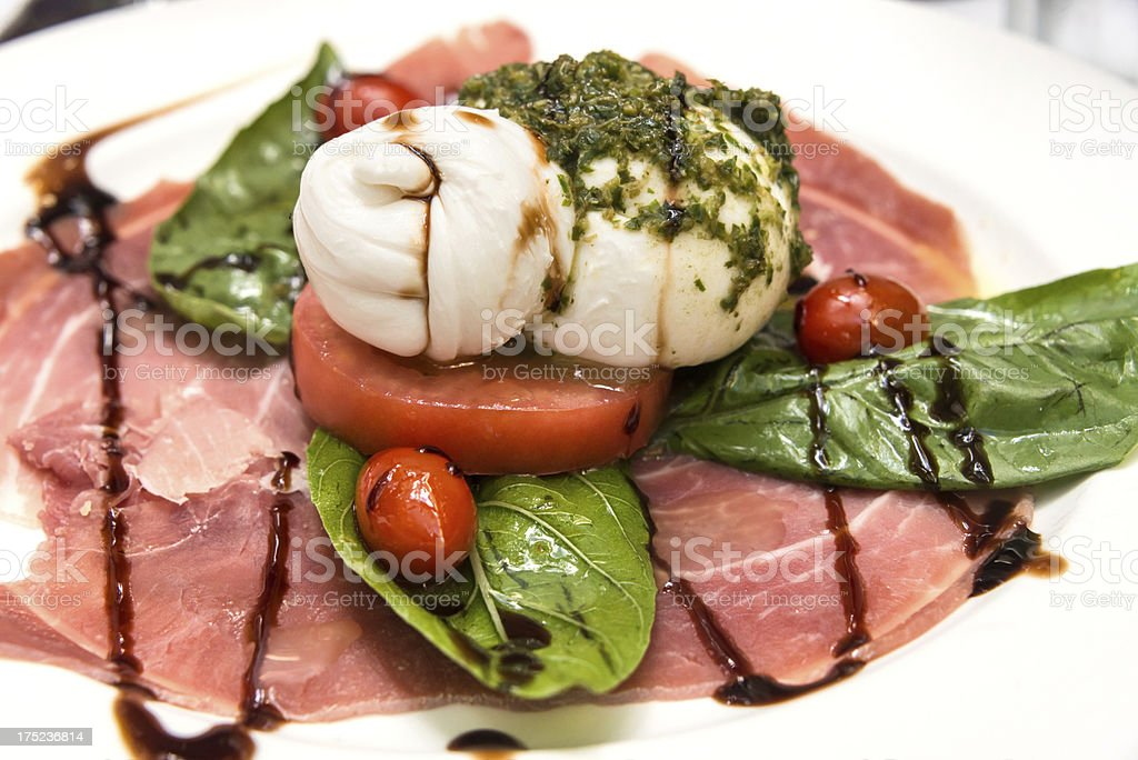 Burratta with italian prosciutto stock photo