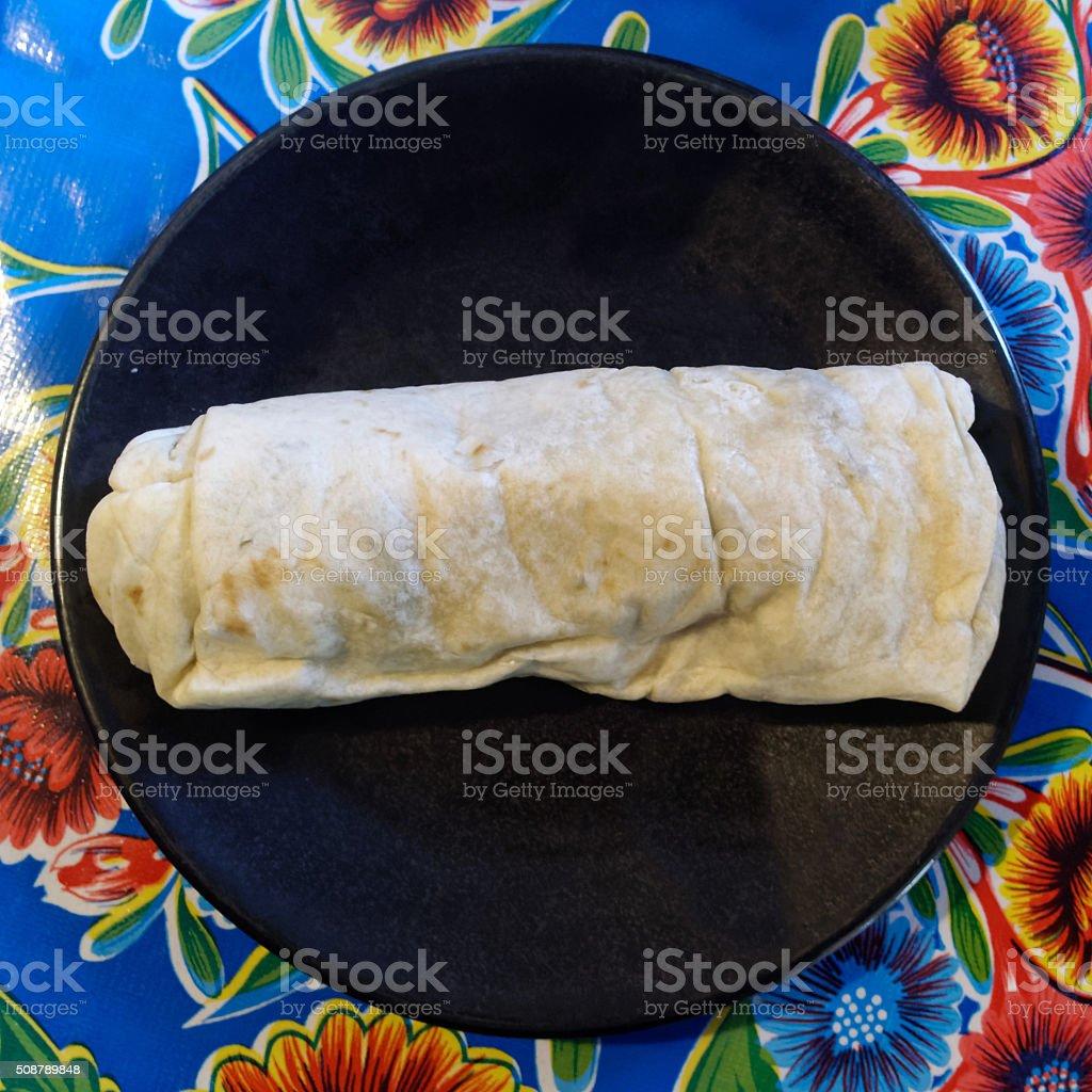 Burrito on Black Plate stock photo