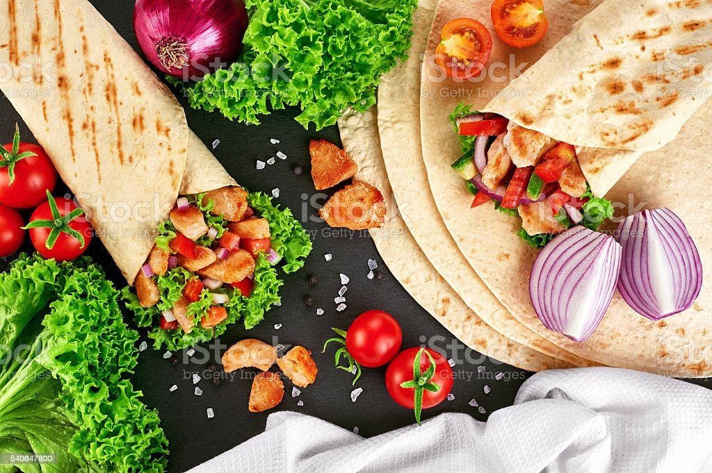 Burrito with grilled chicken and vegetables stock photo
