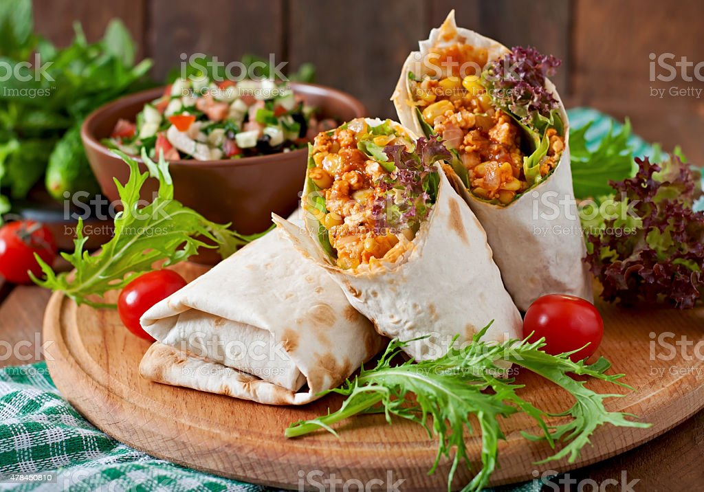 Burritos wraps with minced beef and vegetables stock photo