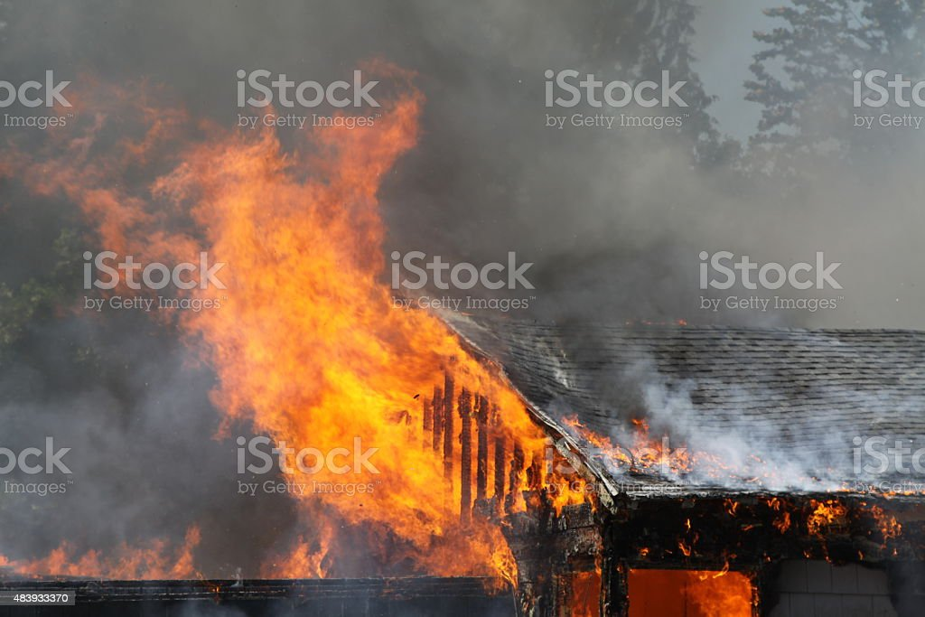 Burst Of Fire Coming From A Burning House stock photo