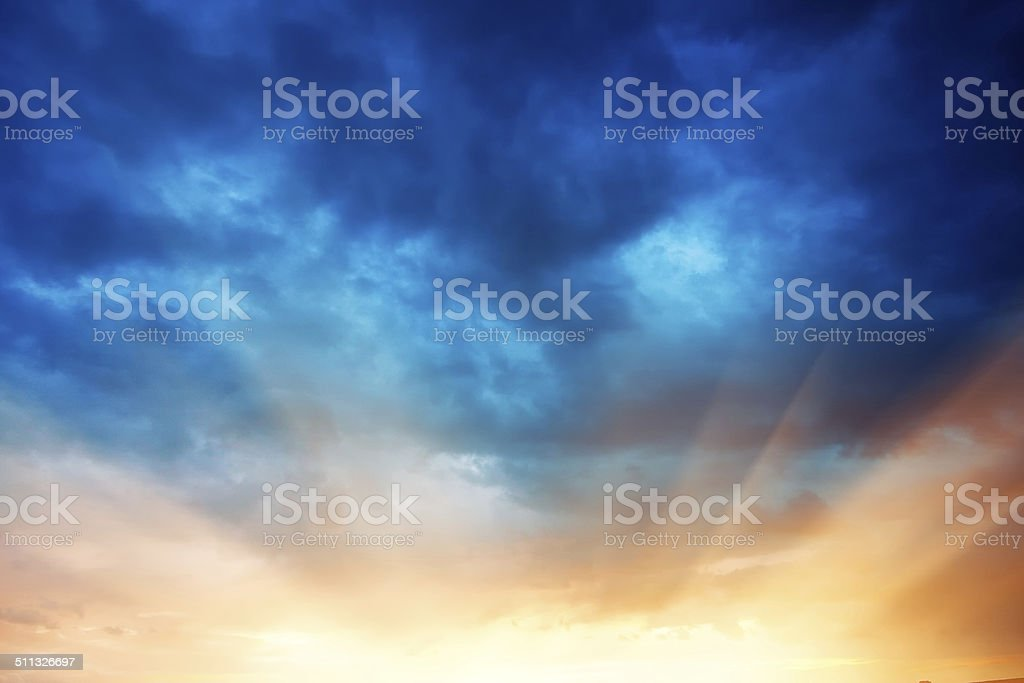 Burst of the sunset over dramatic sky stock photo