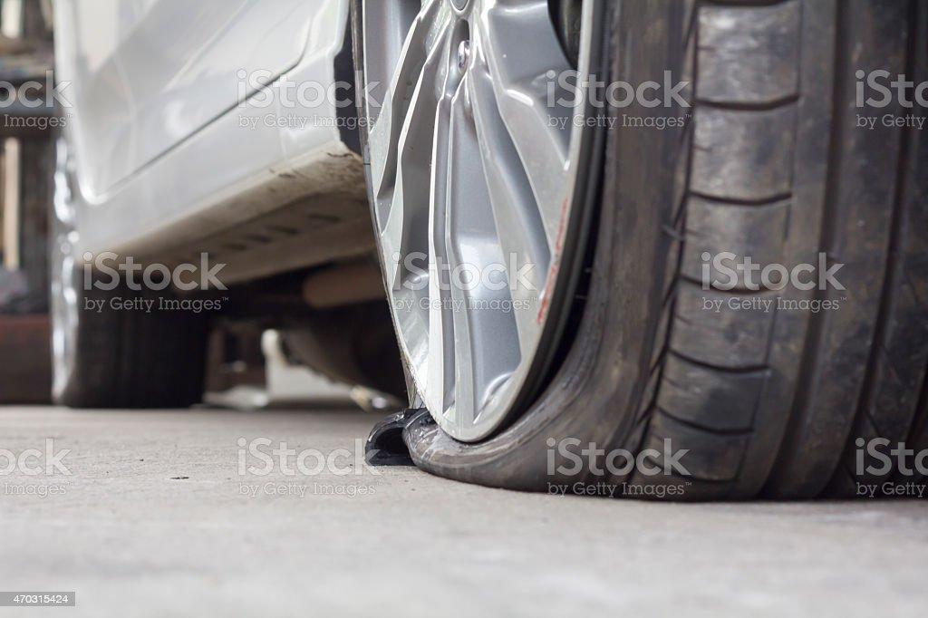 burst tire car stock photo