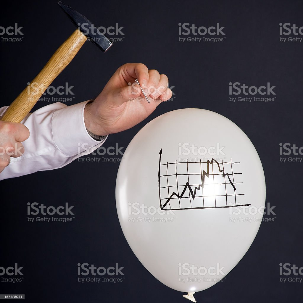 bursting the financial bubble stock photo