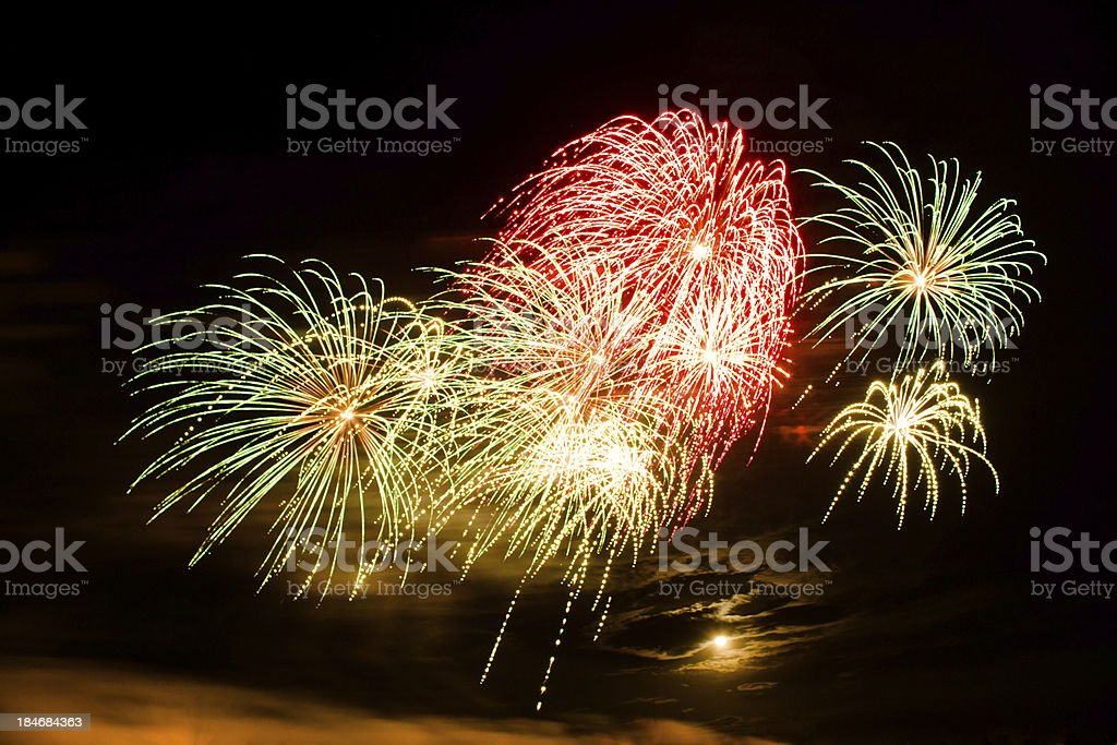 Bursts of Green, Red and Yellow Fireworks royalty-free stock photo