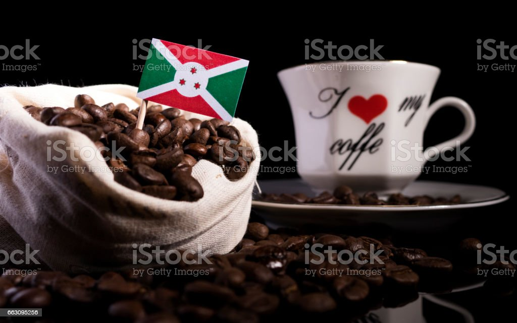 Burundi flag in a bag with coffee beans isolated on black background stock photo