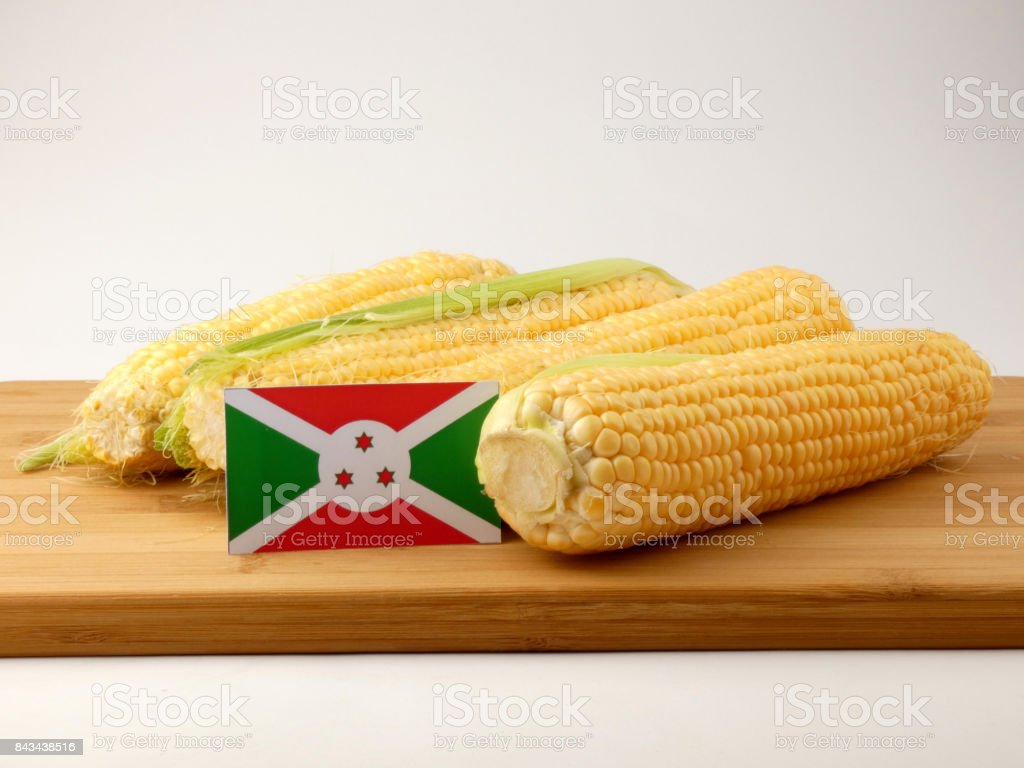 Burundi flag on a wooden panel with corn isolated on a white background stock photo