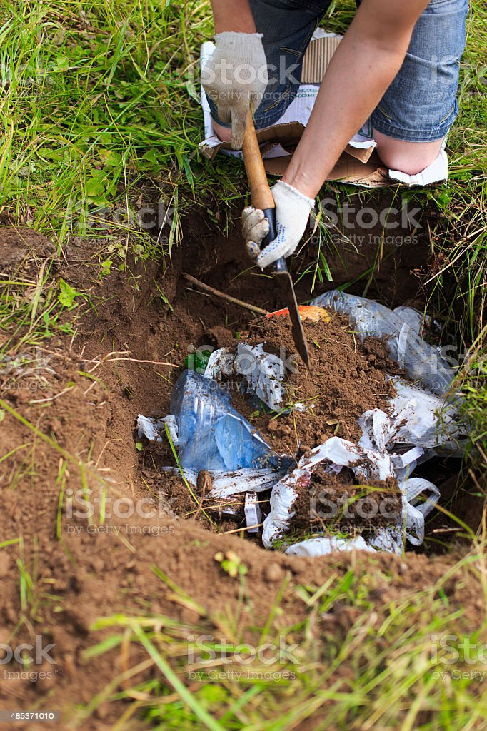 bury trash stock photo