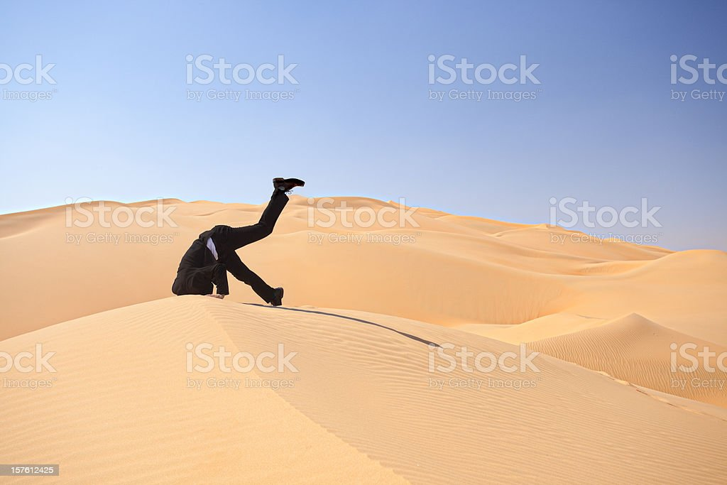 bury your head in the sand stock photo