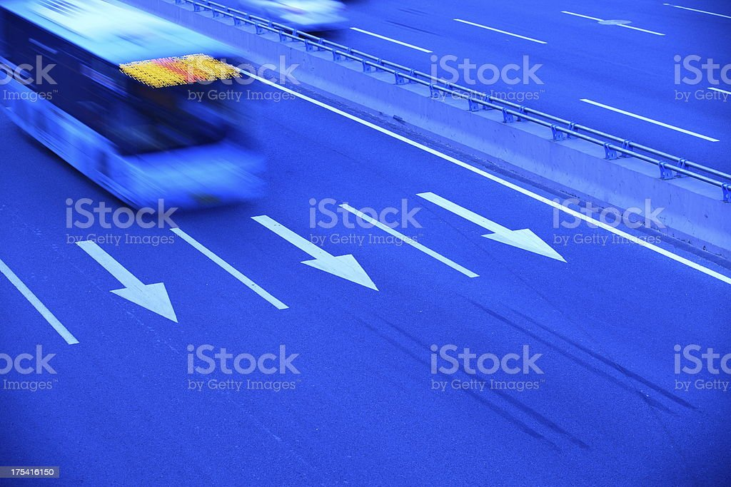 Bus after a multi-lane highways royalty-free stock photo