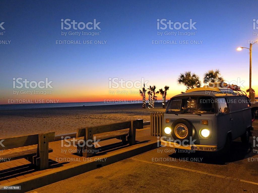 VW Bus after sunset at Gulf of Mexico in Alabama stock photo