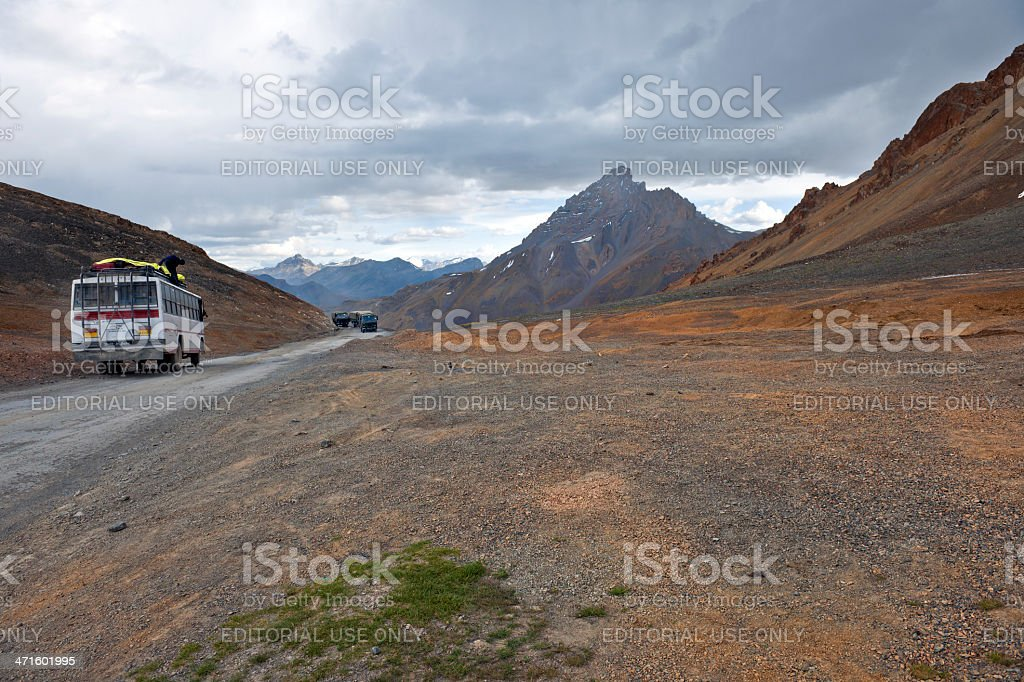 Bus and Military Vehicles on Leh-manali Road India stock photo