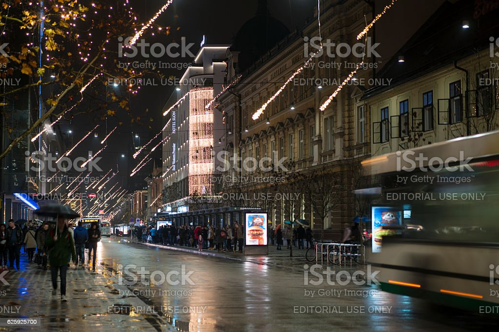 Bus and people on main street  in Ljubljana, Advent Slovenia stock photo