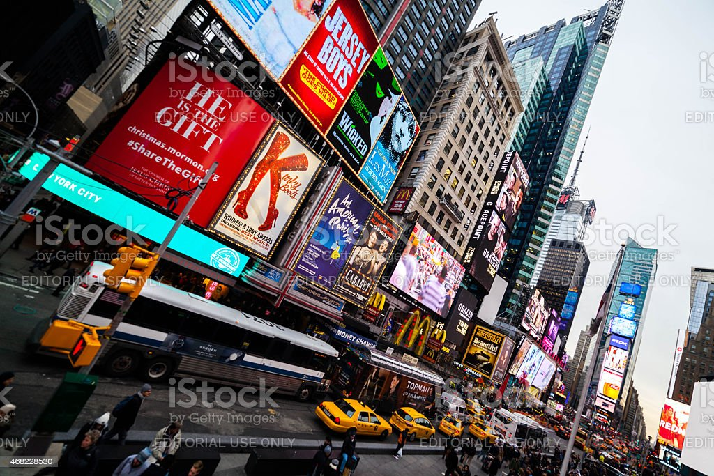 Bus and Taxis in Times Square traffic stock photo