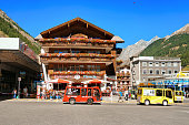 Bus and Tourists at City center in Zermatt Valais