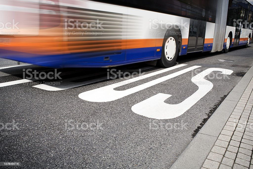 Bus arriving at the station stock photo