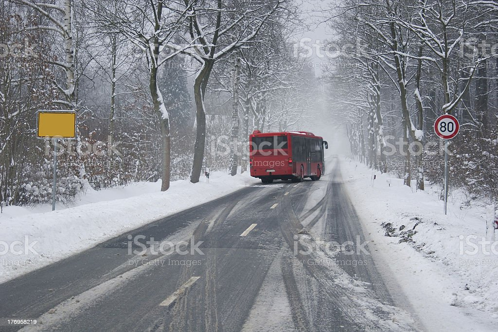 Bus at a slippery winter road stock photo