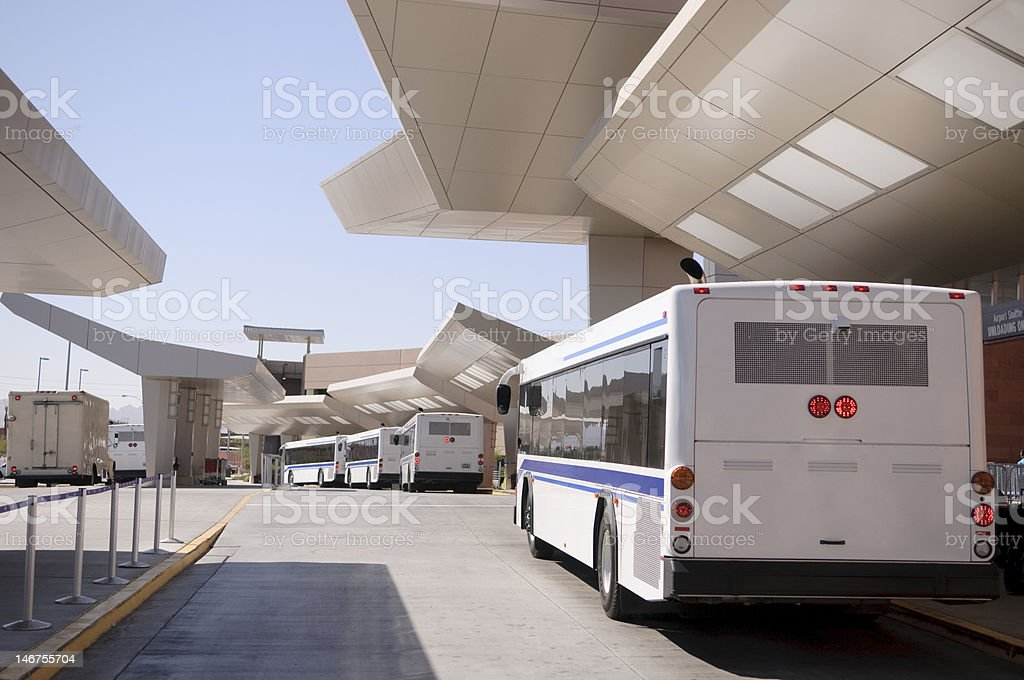 Bus at airport waiting for passengers stock photo