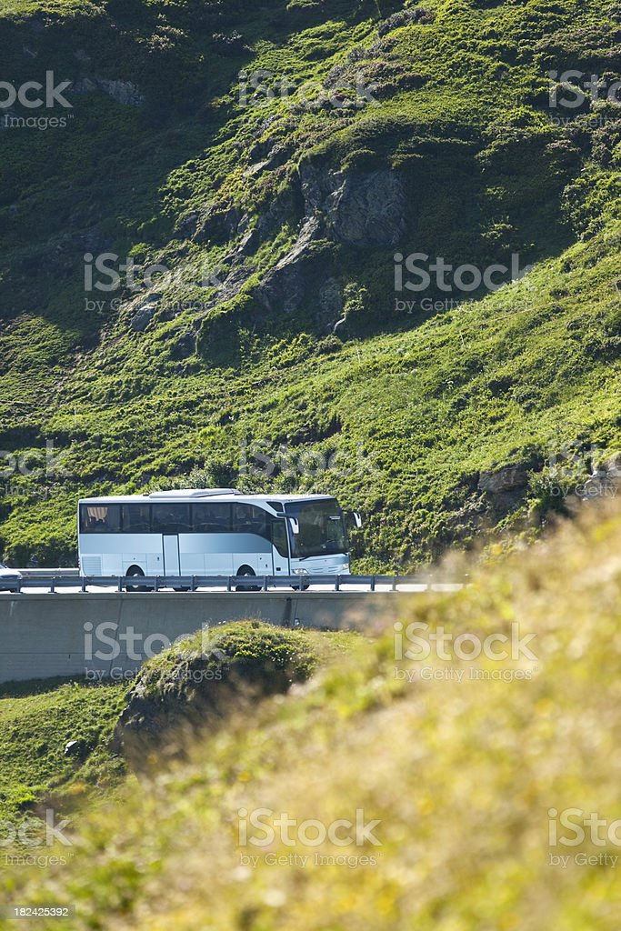 Bus crossing the Alpes near Gotthard Pass stock photo