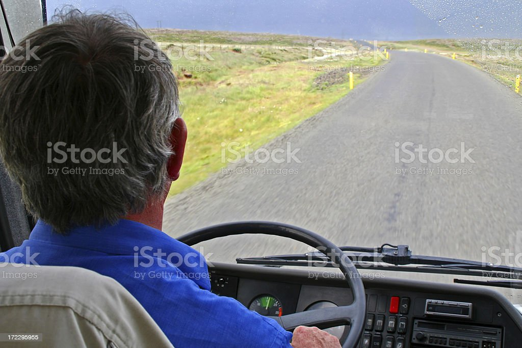Bus driver on empty road with rainy weather stock photo