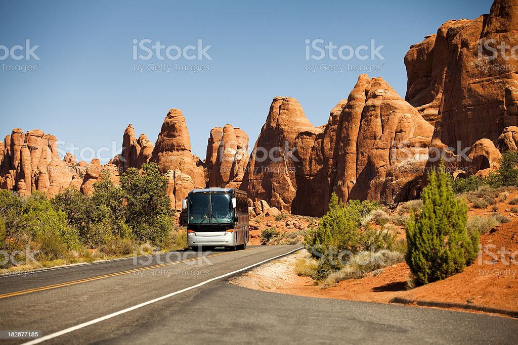 Bus drives in the canyon stock photo