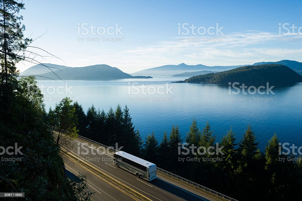Bus driving the Sea to Sky Highway, BC stock photo