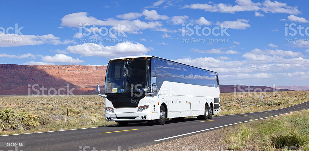 Bus driving through valley Arizona USA stock photo