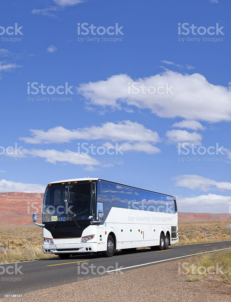 Bus driving through valley in Arizona USA stock photo