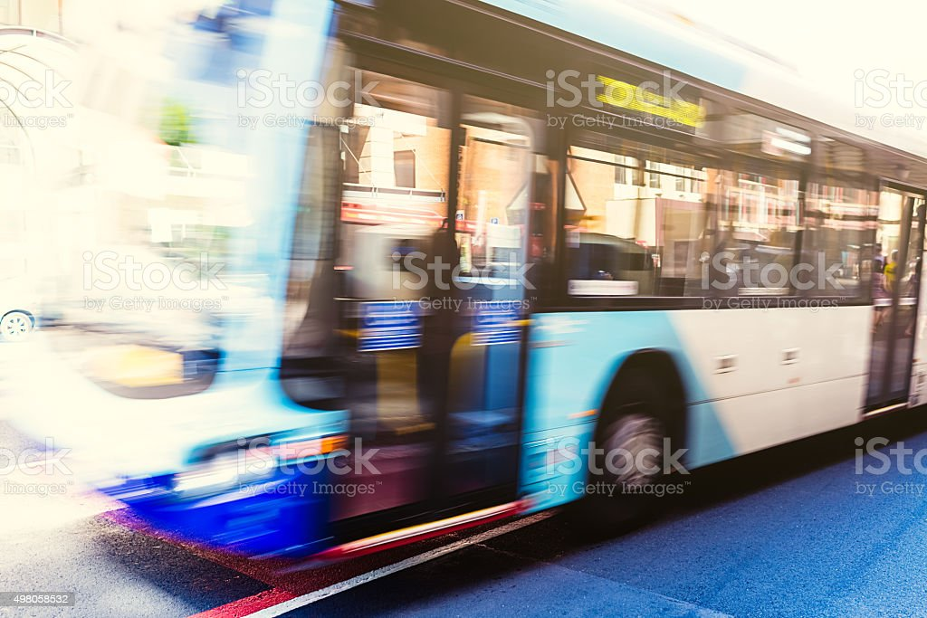 Bus in motion on the street stock photo