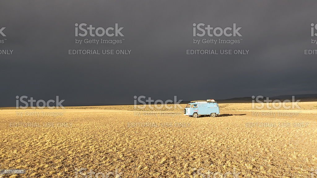 VW Bus in Sunset while thunderstorm is building up stock photo