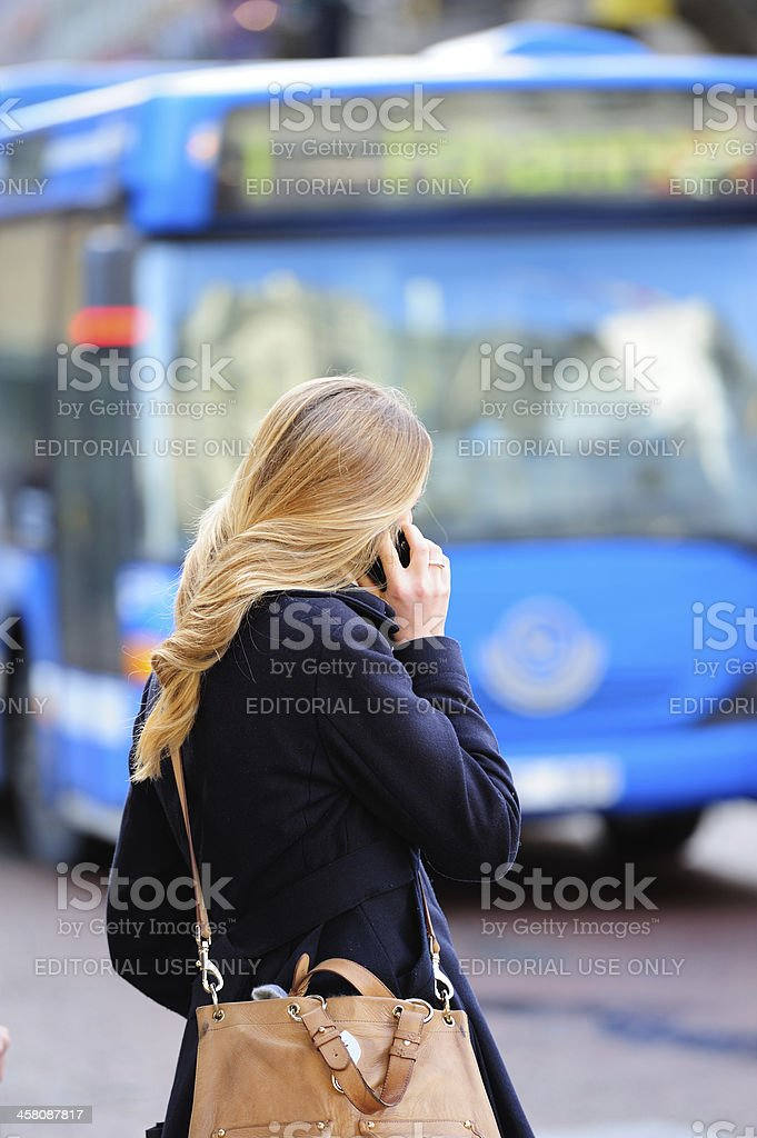 Bus in the city traffic, girl on phone royalty-free stock photo