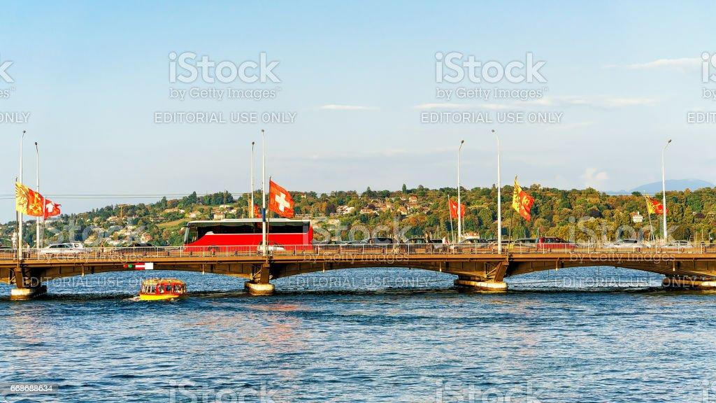 Bus on Bergues Bridge over Geneva Lake stock photo