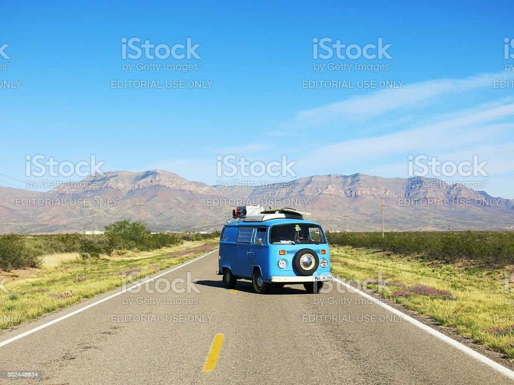 VW Bus on Highway in New Mexico, USA stock photo