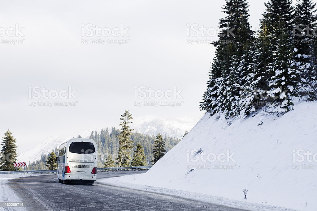 Bus on snowy road stock photo