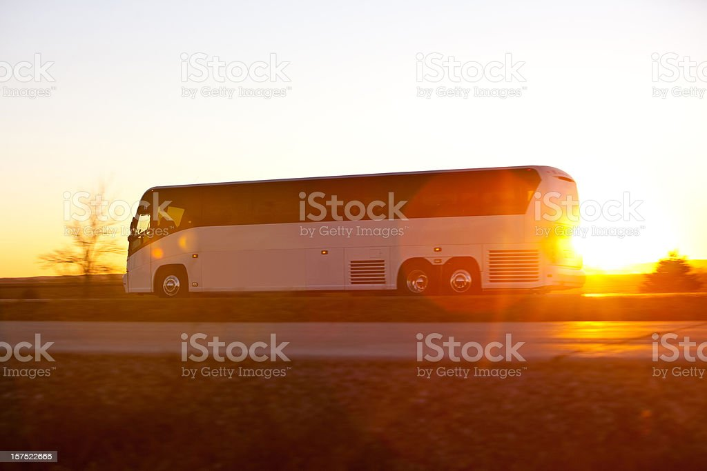 Bus on the highway at sunrise stock photo