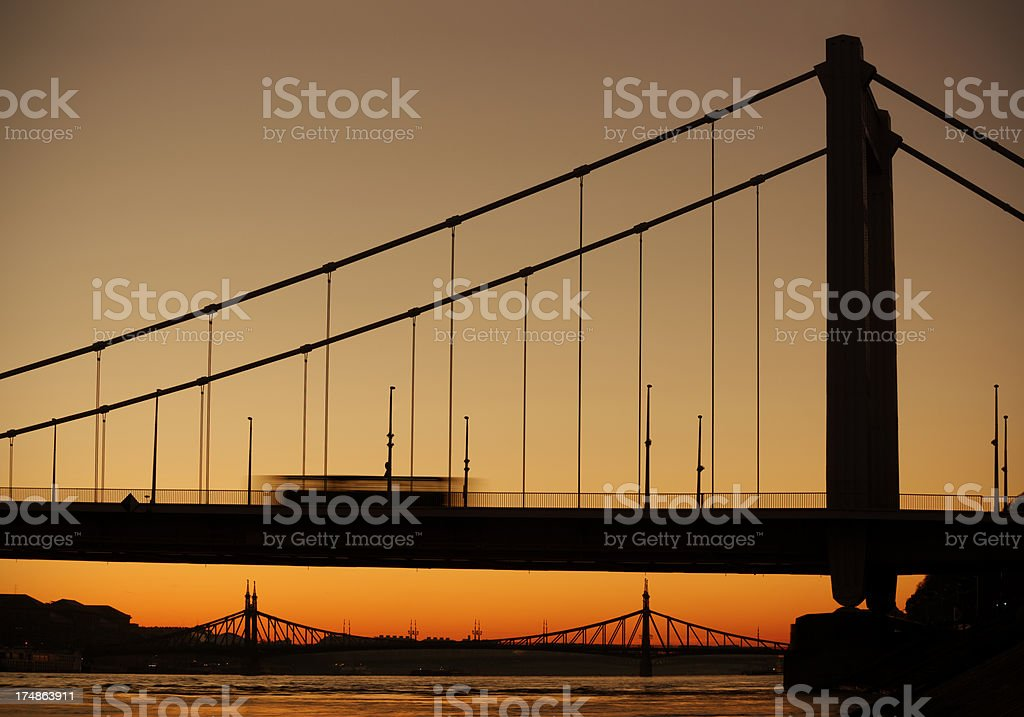 Bus on the road and bridge at sunrise royalty-free stock photo
