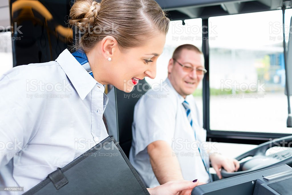Bus or coach driver and tourist guide stock photo