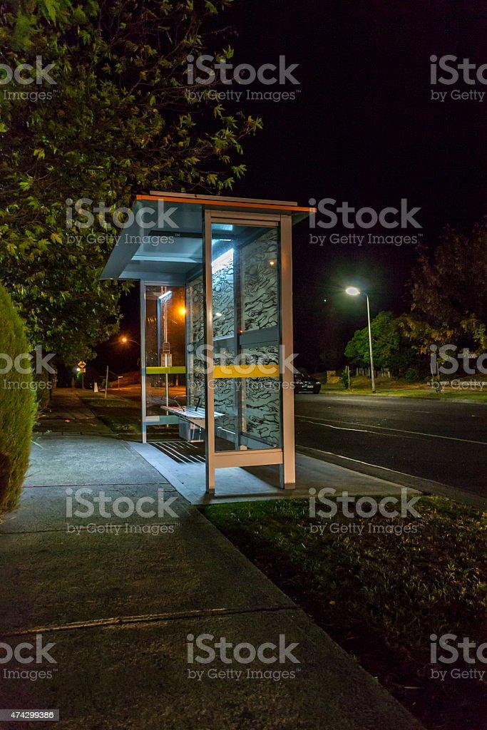 bus shelter at night stock photo