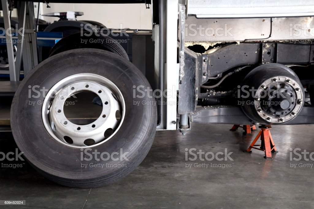 bus spare wheel tire waiting to change at the garage stock photo
