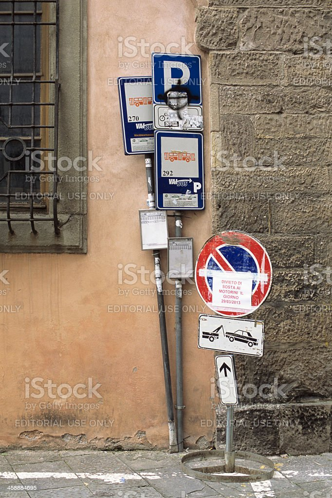 Bus stop and parking sign mess, Italy stock photo