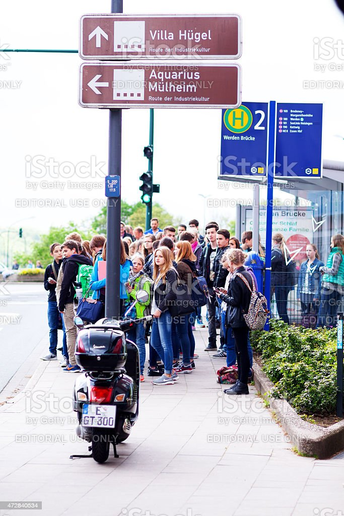 Bus stop in Essen Werden with many teengers and students stock photo