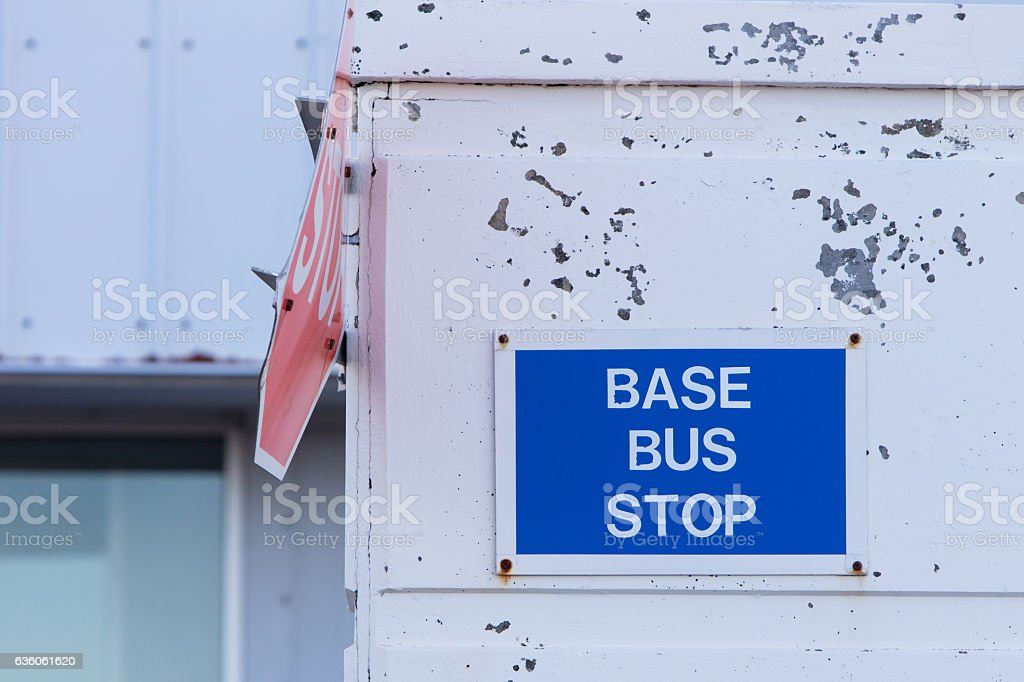 Bus stop sign on a wall stock photo