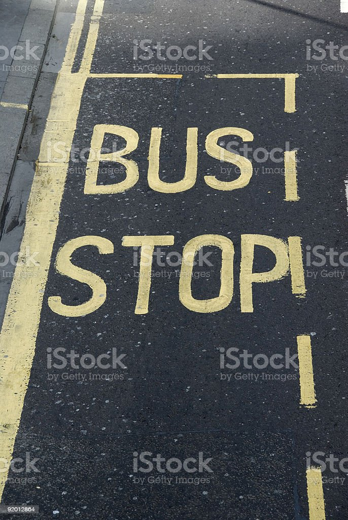 Bus stop sign on road royalty-free stock photo