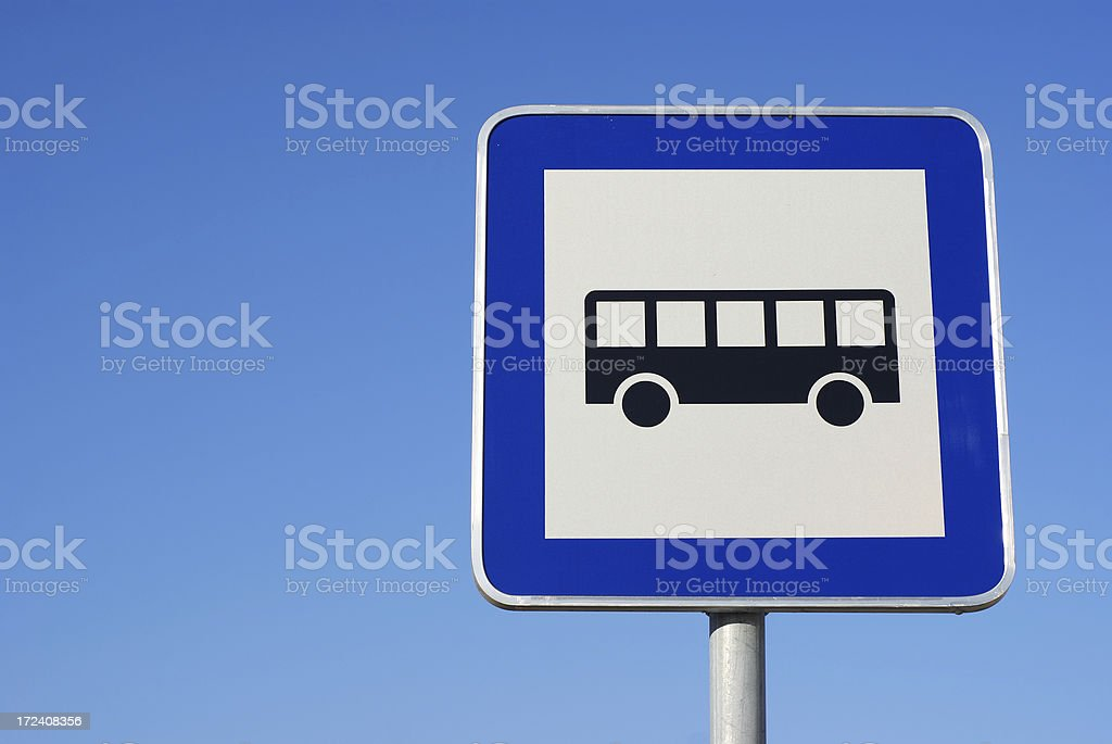 Bus stop traffic sign against blue sky. royalty-free stock photo