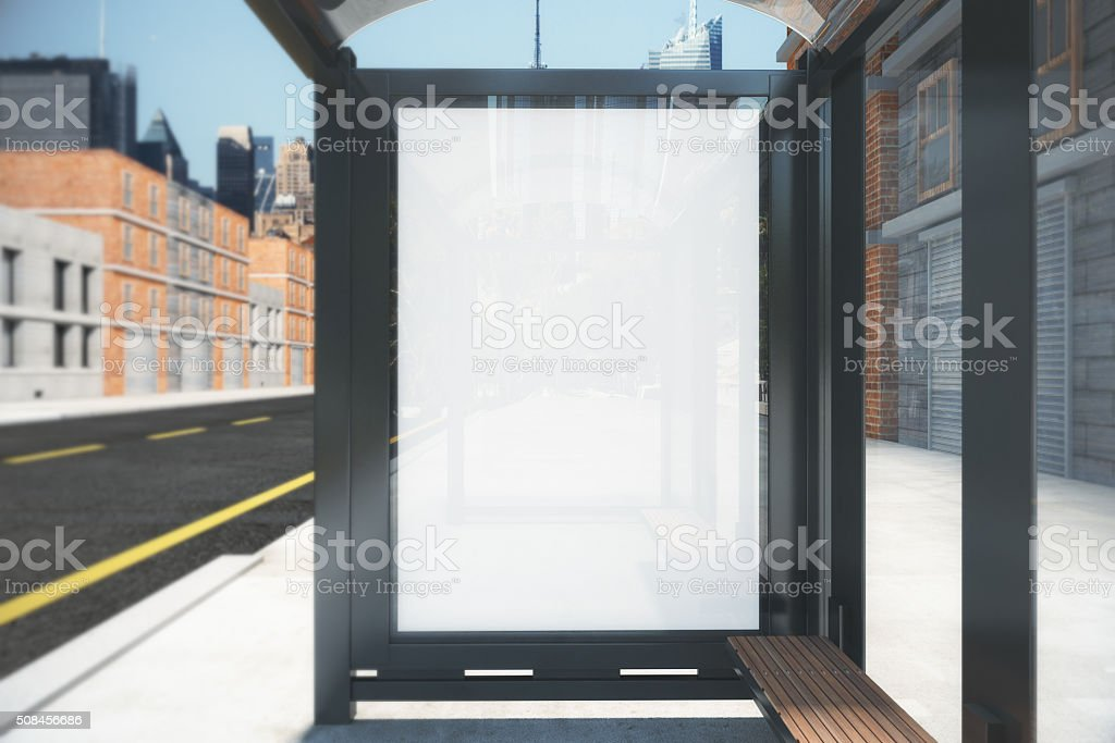 Bus stop with a blank billboard with reflections, mock up stock photo