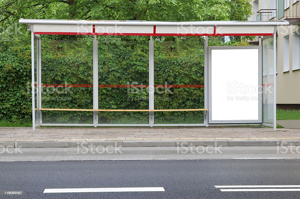 Bus stop with an advertising board royalty-free stock photo
