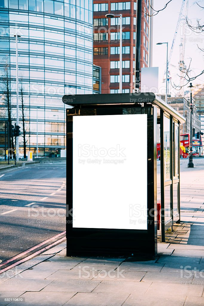 Bus stop with billboard stock photo